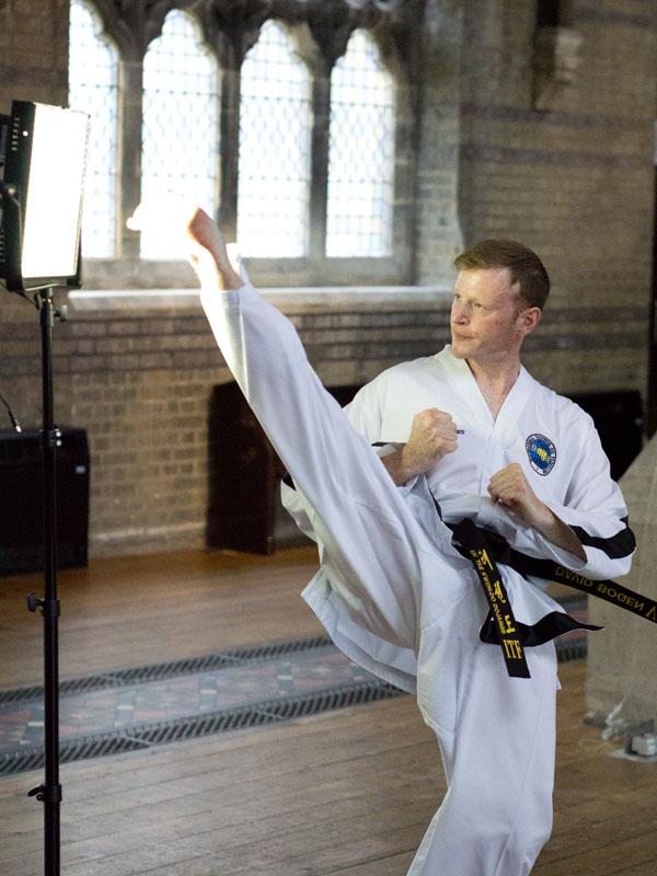 UKTD Secretary Mr David Bogen, 6th Dan, demonstrating Twisting Kick.