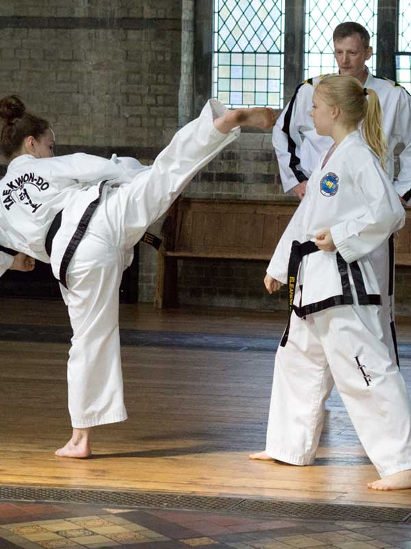 UKTD Black Belts Jade and Ellie run through step sparring with Instructor Mr Bogen