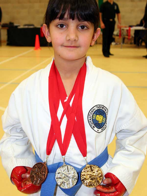 UKTD Student Dunia with her 3 medals from the England Open 2012