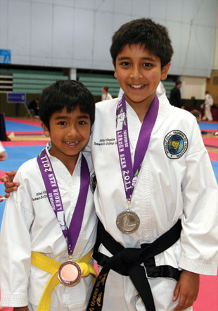 UKTD brothers proudly show their medals
