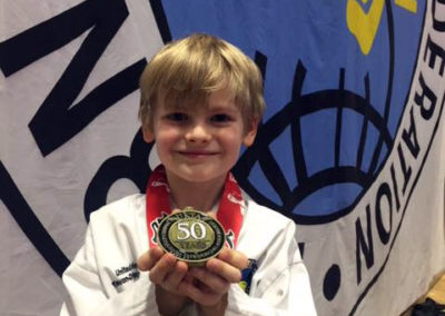 UKTD student Max proudly showing his Gold Medal!