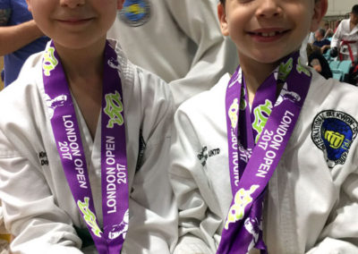 UKTD students Naveh and Tom proudly showing their medals